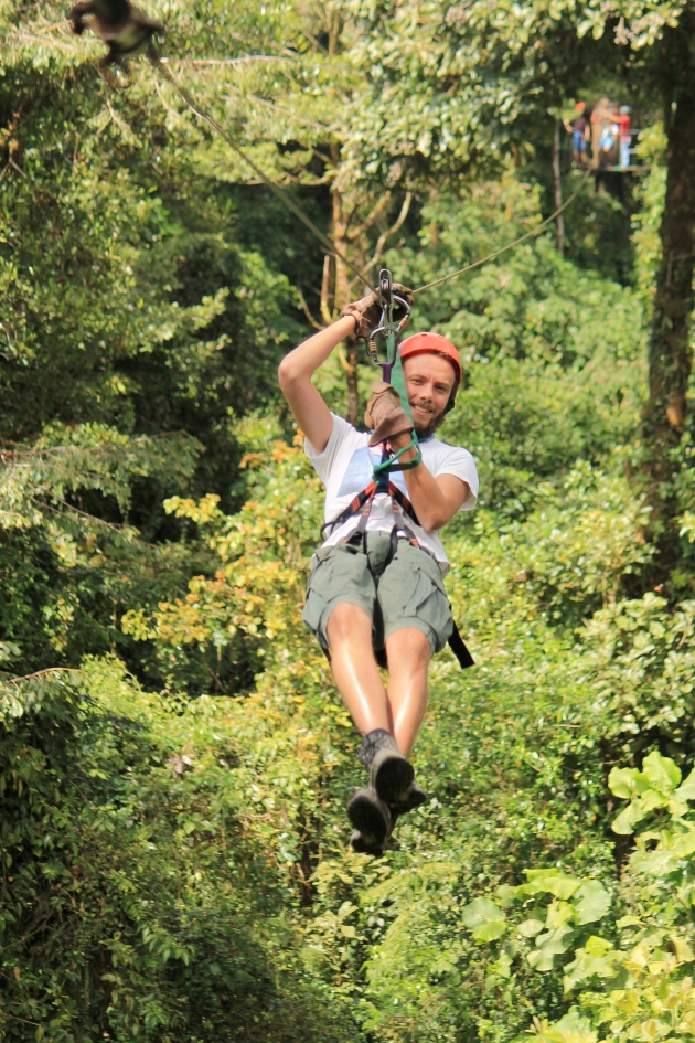 A photo of the author zip lining above a Costa Rican rainforest